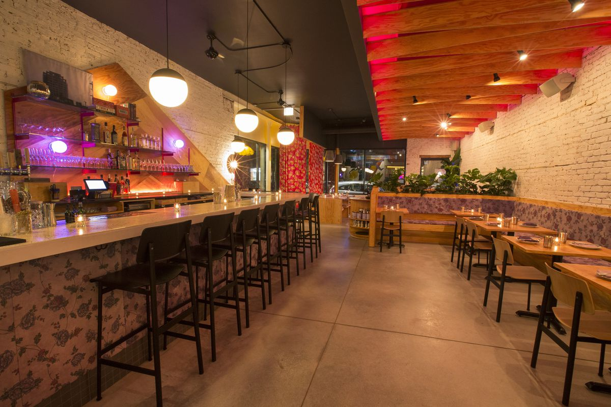 The bar and dining room in a modern Indian restaurant