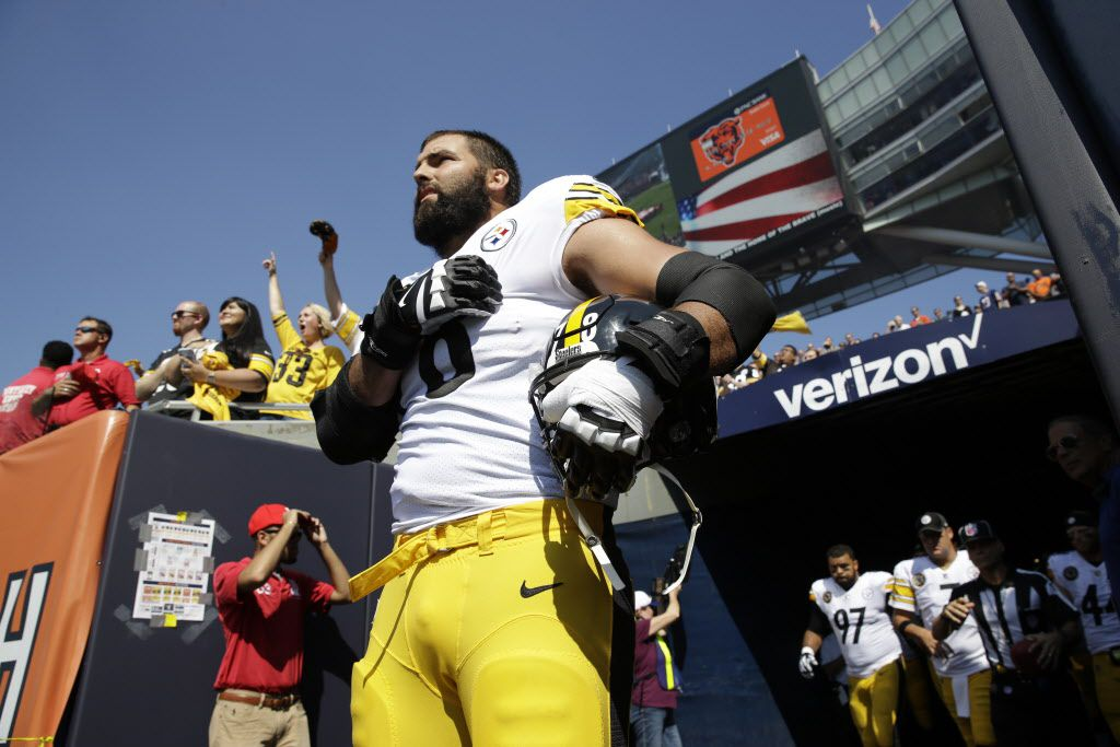 Pittsburgh Steelers offensive tackle and former Army Ranger Alejandro Villanueva stands outside the tunnel alone during the national anthem. | AP Photo