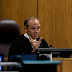 Judge Derek Pullan reacts after unauthorized audio from a media outlet was heard in the courtroom from a device owned by the prosecution during the trial of Martin MacNeill at the Fourth District Court in Provo Wednesday, Nov. 6, 2013. MacNeill is charged with murder for allegedly killing his wife Michele MacNeill in 2007.