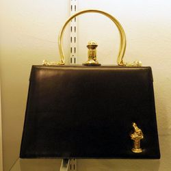 We fell in love with this gorgeous little black leather handbag. Here's looking at you, Dita Von Teese.