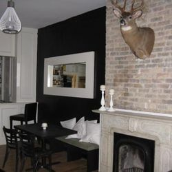 A buck's head mounted on the fireplace wall adds a homey feel to the lounge