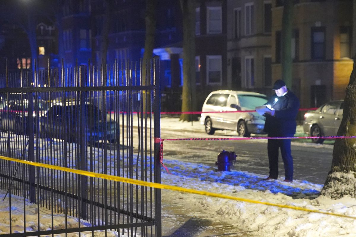 Chicago police investigate the scene of a shooting in which one man was killed and another was wounded Feb. 26, 2020, in the 1400 block of East 69th Place.