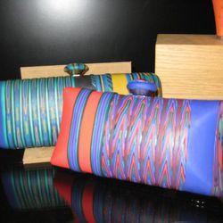Ronnie Kirsch clay clutches, $945-$995