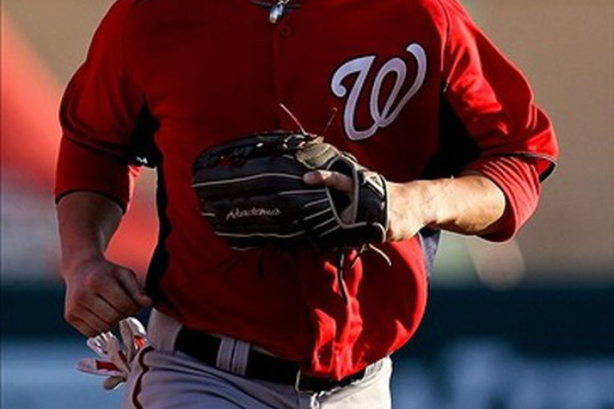 March 14, 2012; Lake Buena Vista, FL, USA; Washington Nationals right fielder Bryce Harper (34) runs in from the outfield after the third inning of the game against the Atlanta Braves at Champion Stadium. Mandatory Credit: Daniel Shirey-US PRESSWIRE