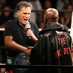 Former Massachusetts Gov. Mitt Romney interviews five-time heavyweight champion Evander Holyfield after Holyfield beat him in a fight at Charity Vision Fight Night at The Rail Event Center in Salt Lake City on Friday, May 15, 2015.