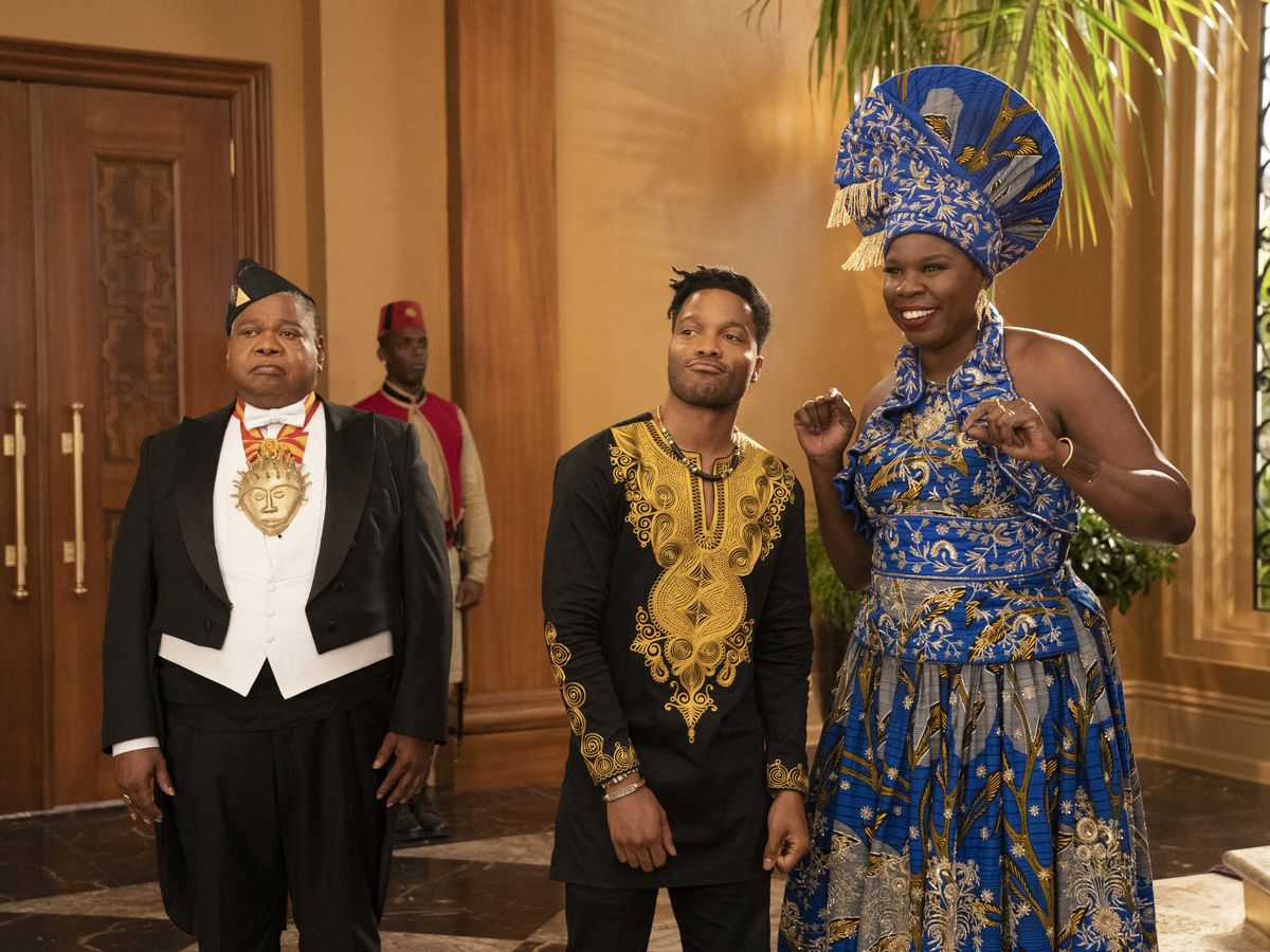 Two men and a woman, in lavish clothing.