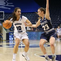 FILE: Brigham Young Cougars forward Malia Nawahine (10) looks for an open teammate as Montana State Bobcats guard Hannah Caudill (23) defends her as BYU and Montana State women play an NCAA basketball game in Provo at the Marriott Center on Friday, Dec. 22, 2017.