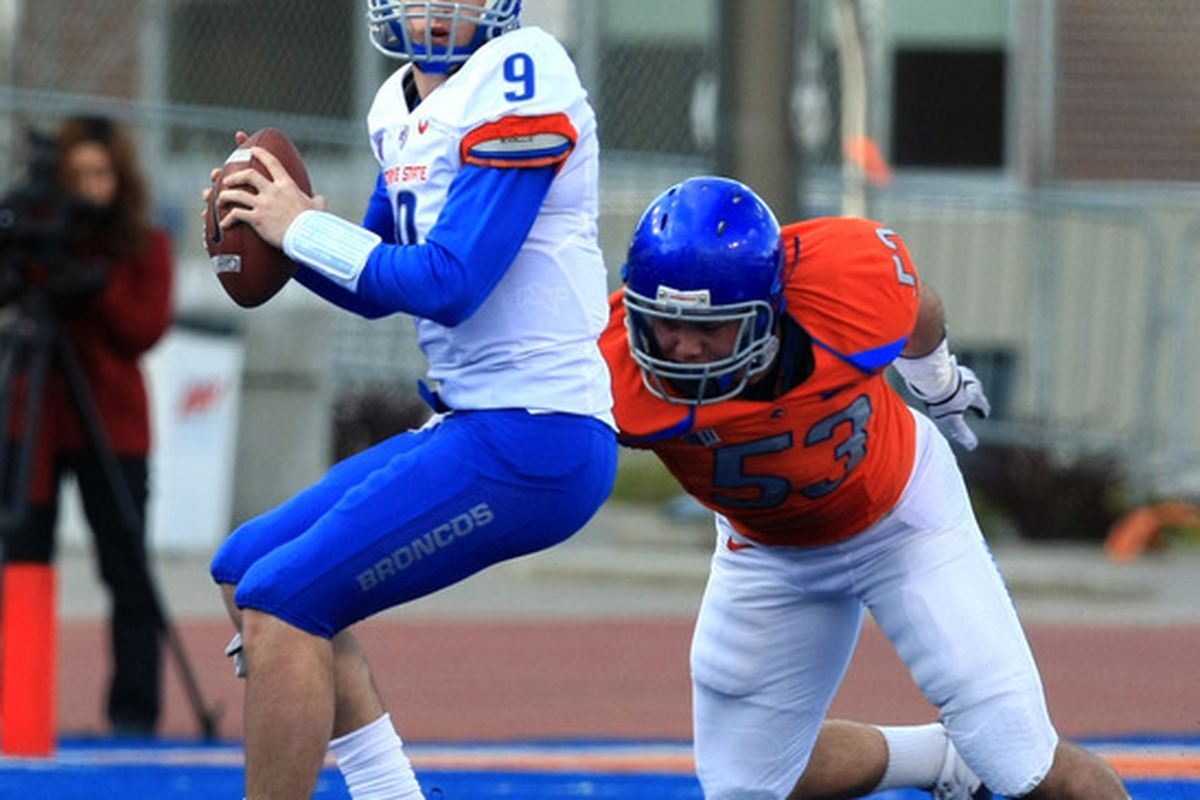 April 16, 2012; Boise, ID, USA; Boise State Broncos quarterback Grant Hendrick (9) sets up to pass under pressure from defensive tackle Beau Martin (53)  during the spring game at Bronco Stadium.  Mandatory Credit: Brian Losness-US PRESSWIRE