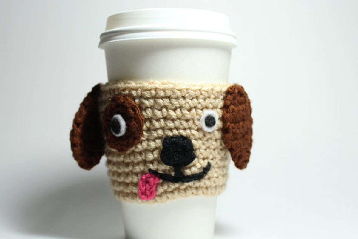 "Image via <a href=""https://www.etsy.com/listing/108033974/coffee-cozy-puppy-crochet-animal-drink?ref=shop_home_active_19"">Etsy</a>/Ms Amanda Jayne"