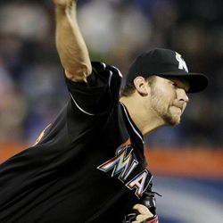 Miami Marlins starting pitcher Josh Johnson delivers during the second inning of a baseball game against the New York Mets, Tuesday, April 24, 2012, at Citi Field in New York.