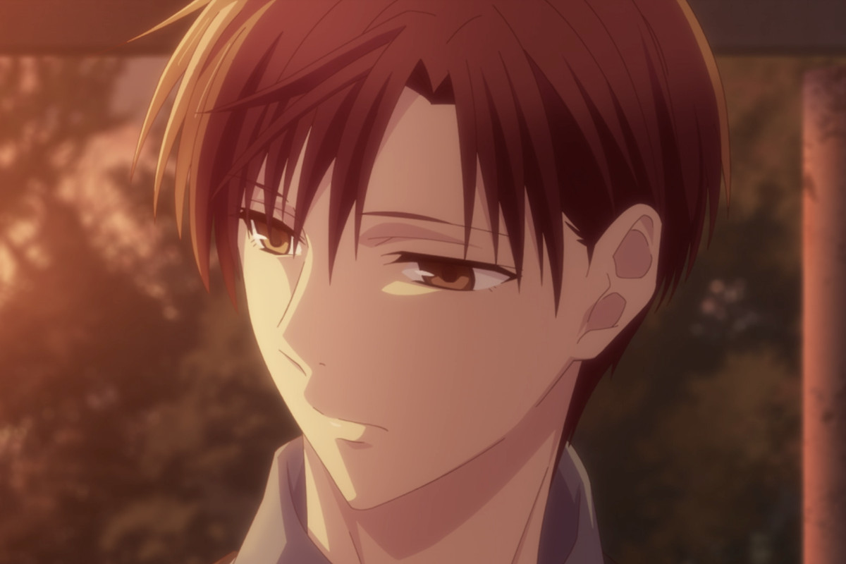 kureno from fruits basket, a man with light brown hair, looking forlorn in golden swathed lighting