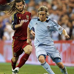 KANSAS CITY, KS - APRIL 14:  Chance Myers #7 of Sporting Kansas City battles Kyle Beckerman #5 of Real Salt Lake for the ball during the Major League Soccer game on April 14, 2012 at Livestrong Sporting Park in Kansas City, Kansas.  (Photo by Jamie Squire/Getty Images)