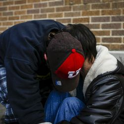 """Criss, left, hugs Karren Cardenas, 45, right,  outside the Catholic Community Services (200 S. and 500 W.) next to the Road Home, called """"The Block,"""" in Salt Lake City on Wednesday, March 8, 2017. Karren has lived on the street for seven years and hasn't seen her father or her six children in years. She suffers from nerve damage, high blood pressure and PTSD."""
