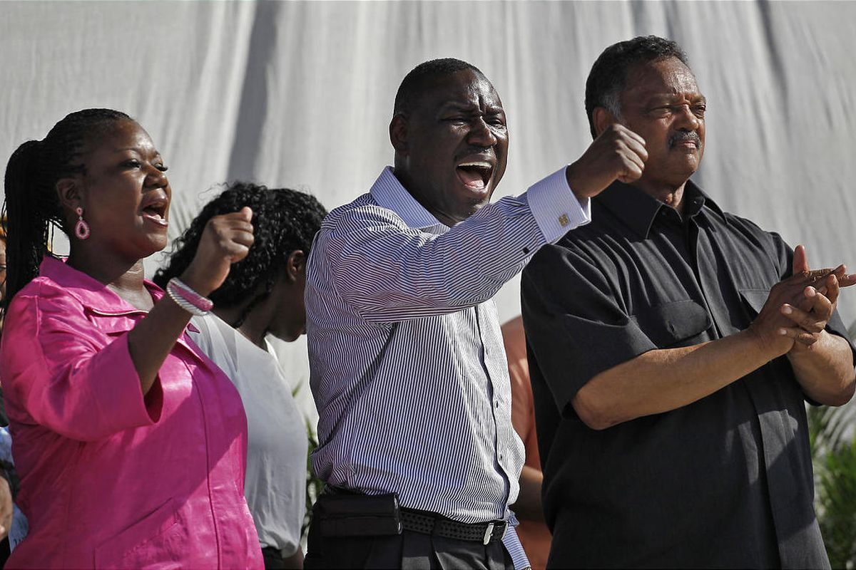 Trayvon Martin's mother, Sybrina Fulton, left, family attorney Benjamin Crump and Rev. Jesse Jackson demand justice for Trayvon during a rally in Miami on Sunday.