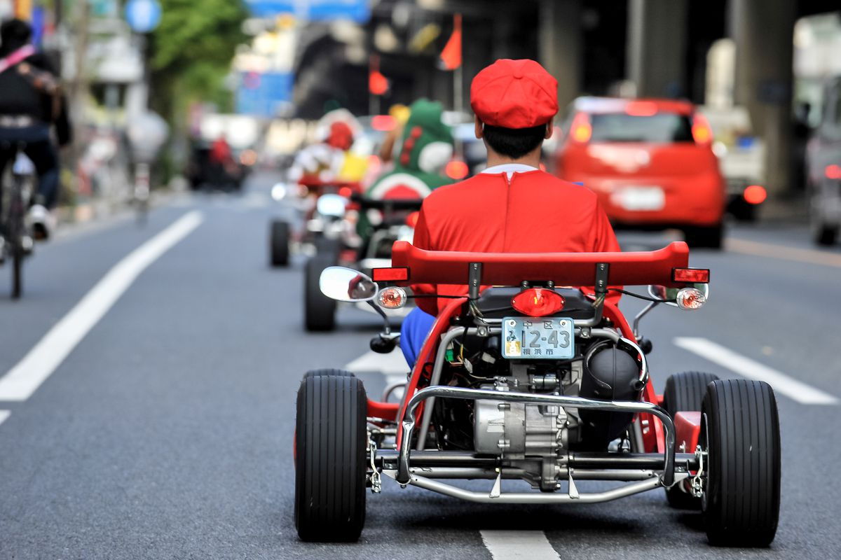 Participants drive around Tokyo in Mario Kart characters for the Real Mario Kart in Tokyo on November 16, 2014 in Tokyo, Japan. The organizer calls for participants to this event held about once a month on Facebook, and Akiba Kart offers rental karts that