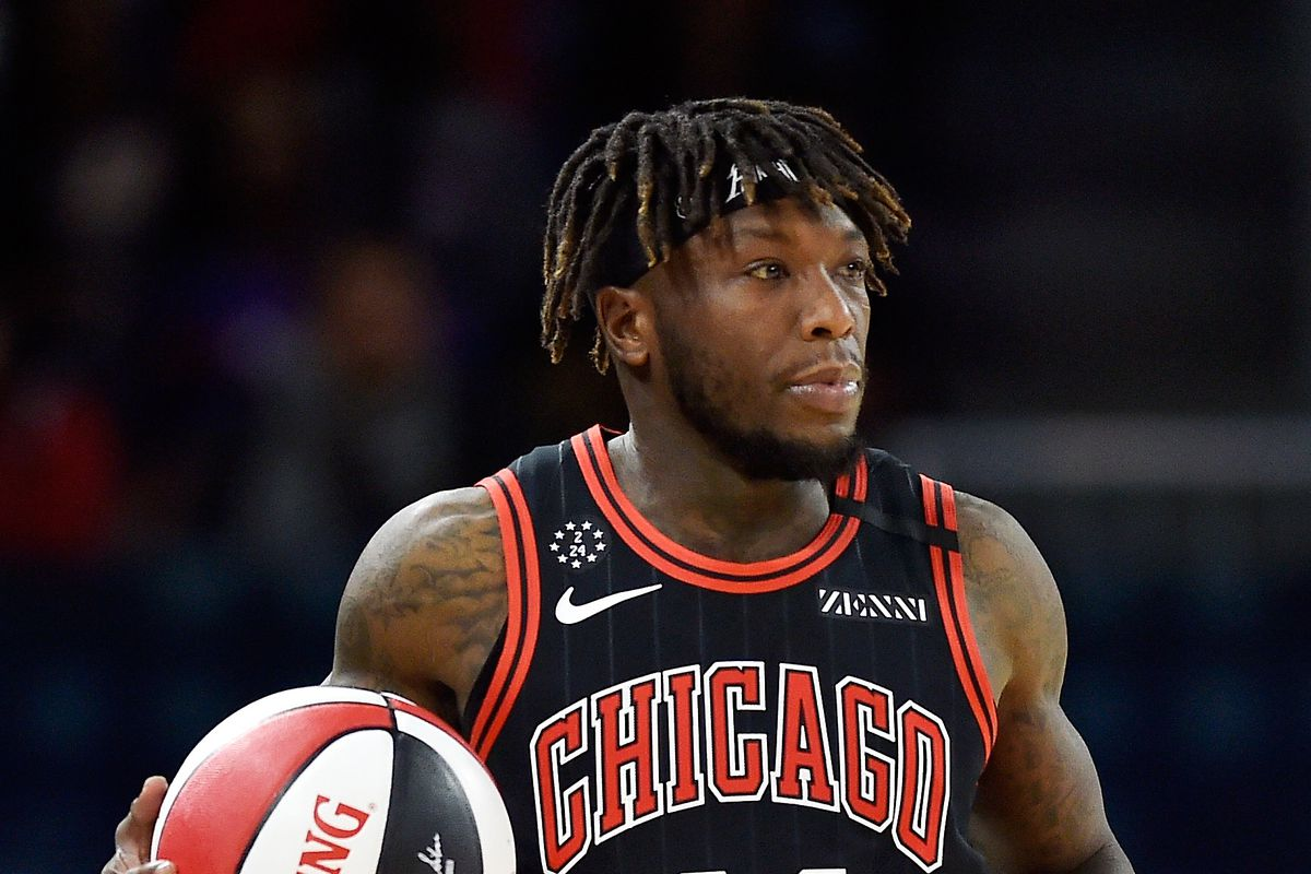 Former Chicago Bulls player Nate Robinson, playing for team Stephen A., dribbles the ball against Team Wilbon during the NBA All Star-Celebrity Game at Wintrust Arena.