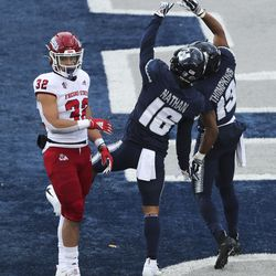 Utah State Aggies wide receiver Jordan Nathan (16) and Utah State Aggies wide receiver Deven Thompkins (13) celebrate completion to Nathan just short of the goal line in Logan on Saturday, Nov. 14, 2020.