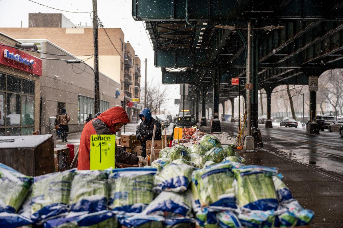 A vendor sells fresh produce in the northeast Bronx, Feb. 19, 2021.