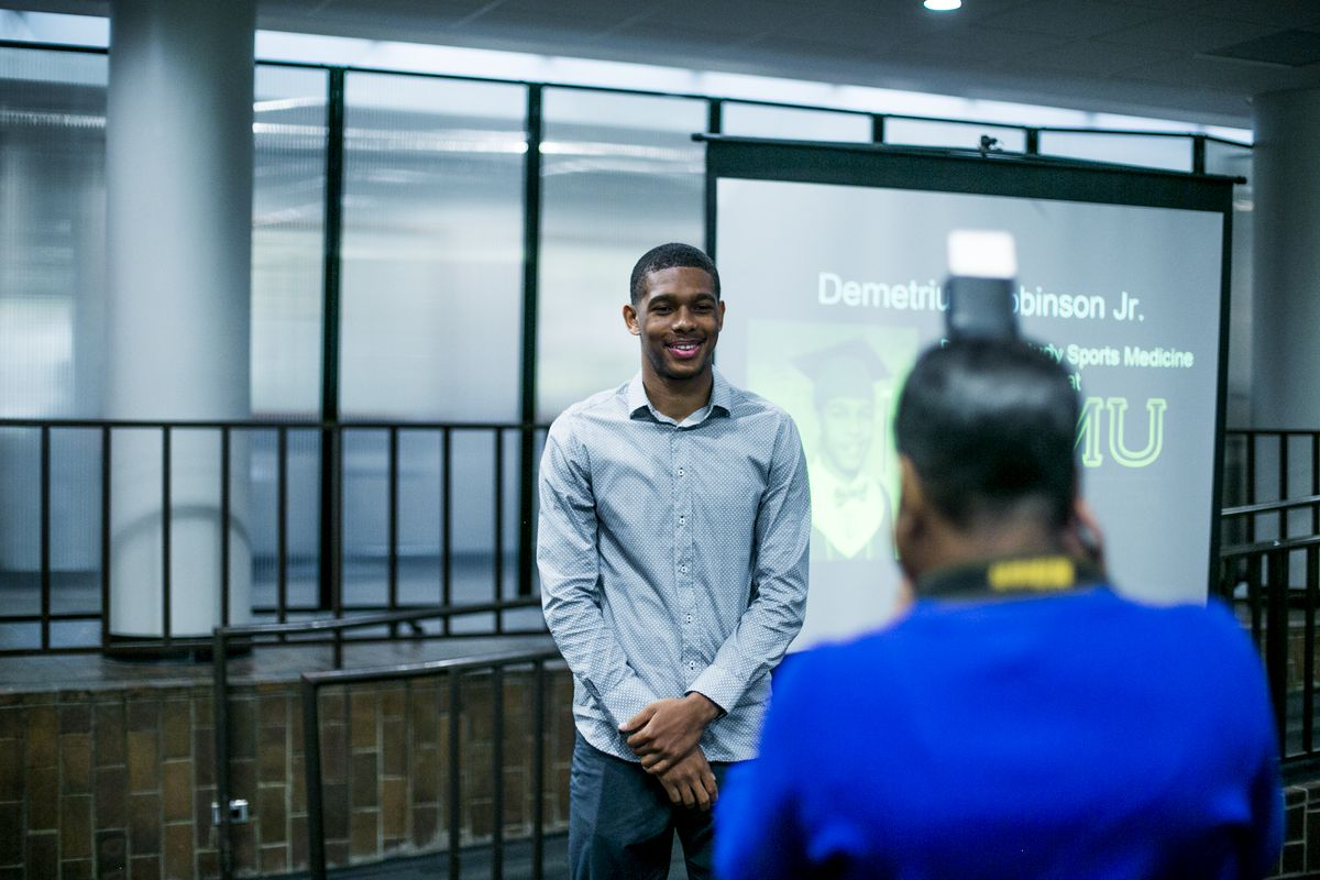 Demetrius Robinson, Jr., participates in a pinning ceremony in May for students graduating from the Jalen Rose Leadership Academy.