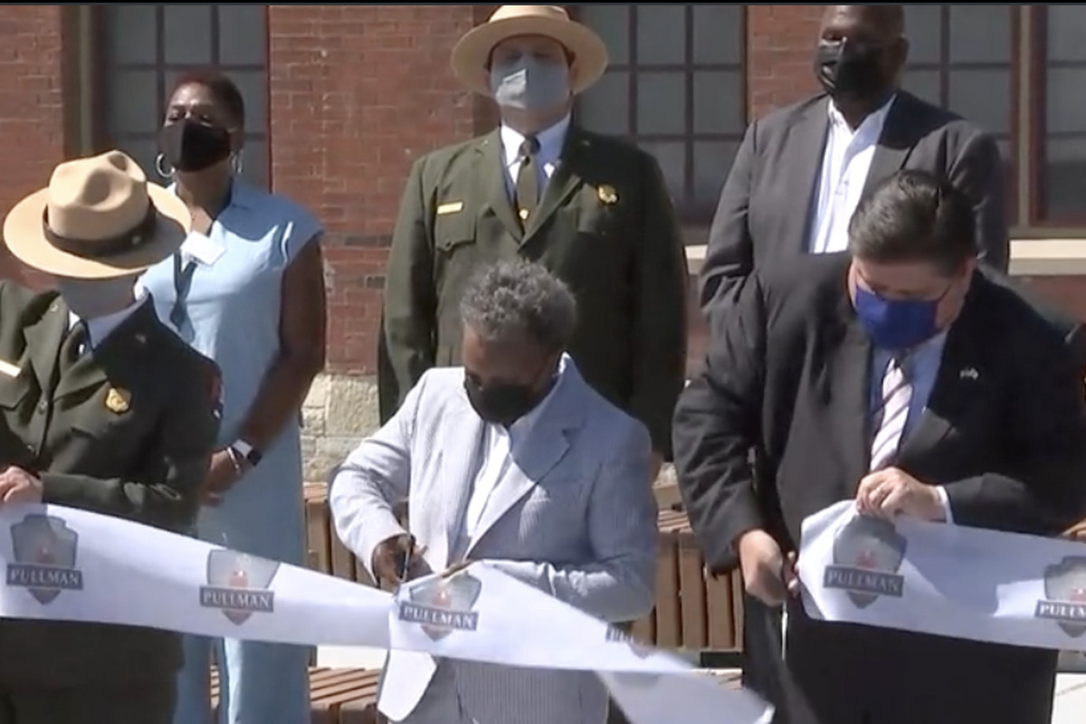 Mayor Lori Lightfoot and Gov. J.B. Pritzker cut the ribbon at the visitor center for the Pullman National Monument on Monday, Sept. 6, 2021.