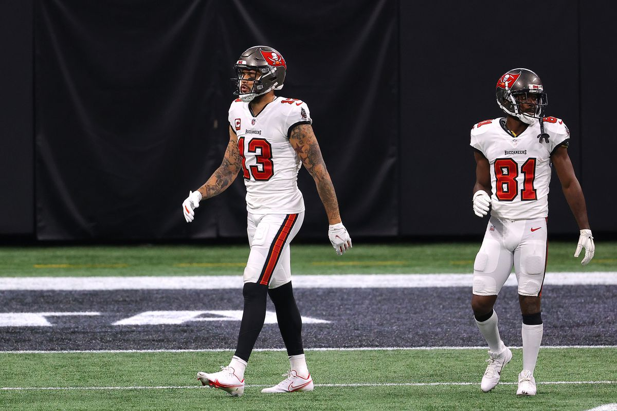 Mike Evans #13 of the Tampa Bay Buccaneers walks off the field after a reception against the Atlanta Falcons during the third quarter in the game at Mercedes-Benz Stadium on December 20, 2020 in Atlanta, Georgia.