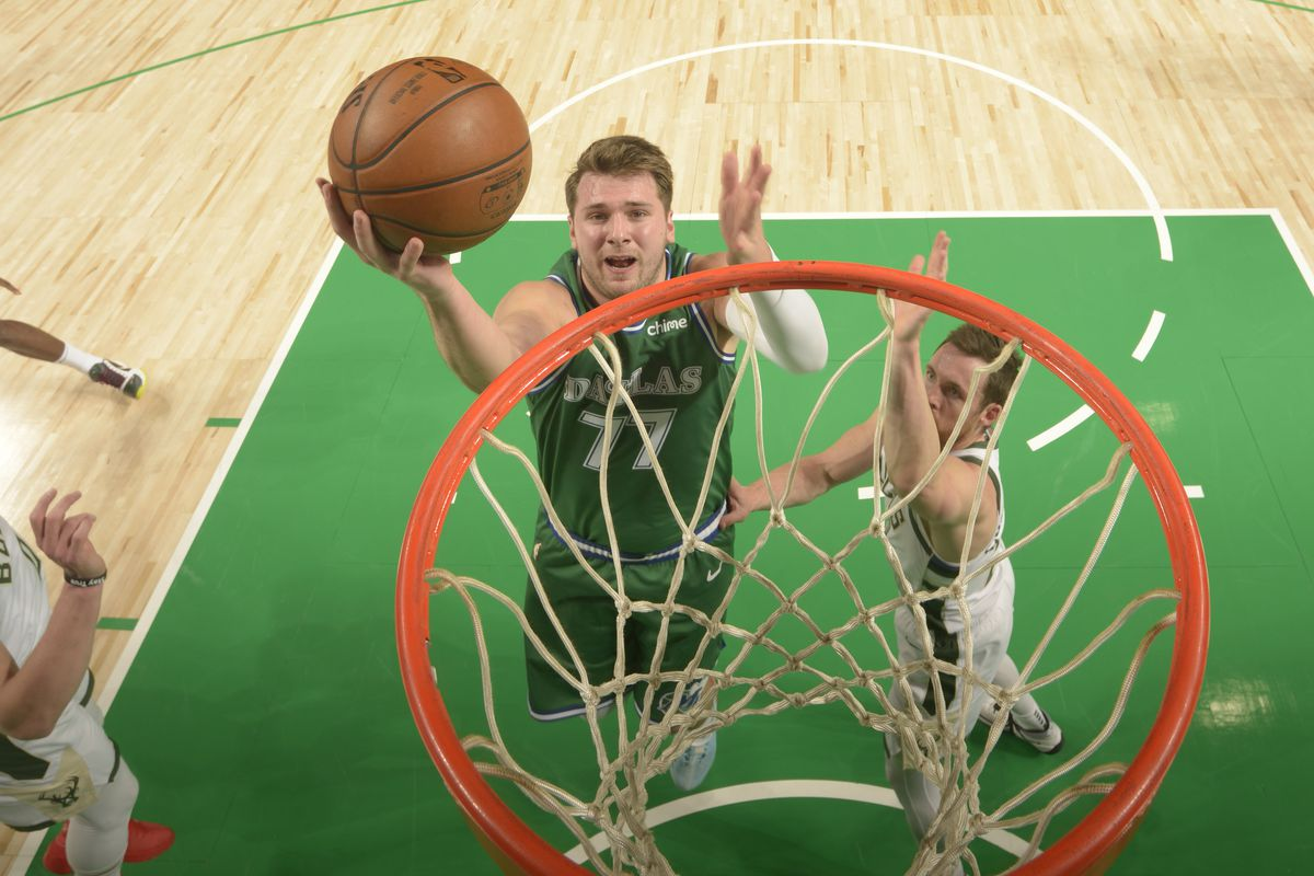 Luka Doncic of the Dallas Mavericks drives to the basket during the game against the Milwaukee Bucks on April 8, 2021 at the American Airlines Center in Dallas, Texas.