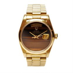 """Vintage 18K gold Rolex Day-Date with rare Tiger's Eye dial, $28,500 at <a href=""""http://modaoperandi.com/cmt-fine-watch-and-jewelry-advisors/gg13/accessories-2330/item/vintage-18k-gold-rolex-day-date-with-rare-tigers-eye-dial-265373"""">Moda Operandi</a>."""