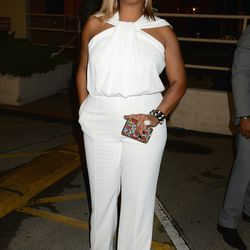 Queen Latifah looks thrilled in a white jumpsuit.