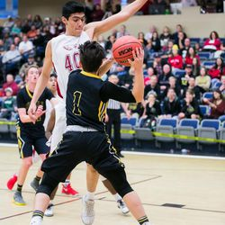 Lino Saez (40) defense the drive from the Roy point guard. The Eagles from Layton Christian upset 5A Roy Royals 67-59, Friday December 8, 2017.