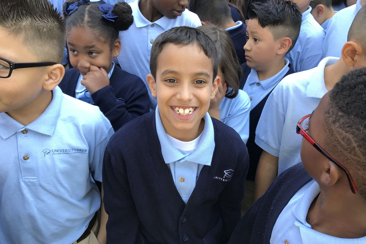 University Prep Steele Street students at a celebration of their test scores Friday.