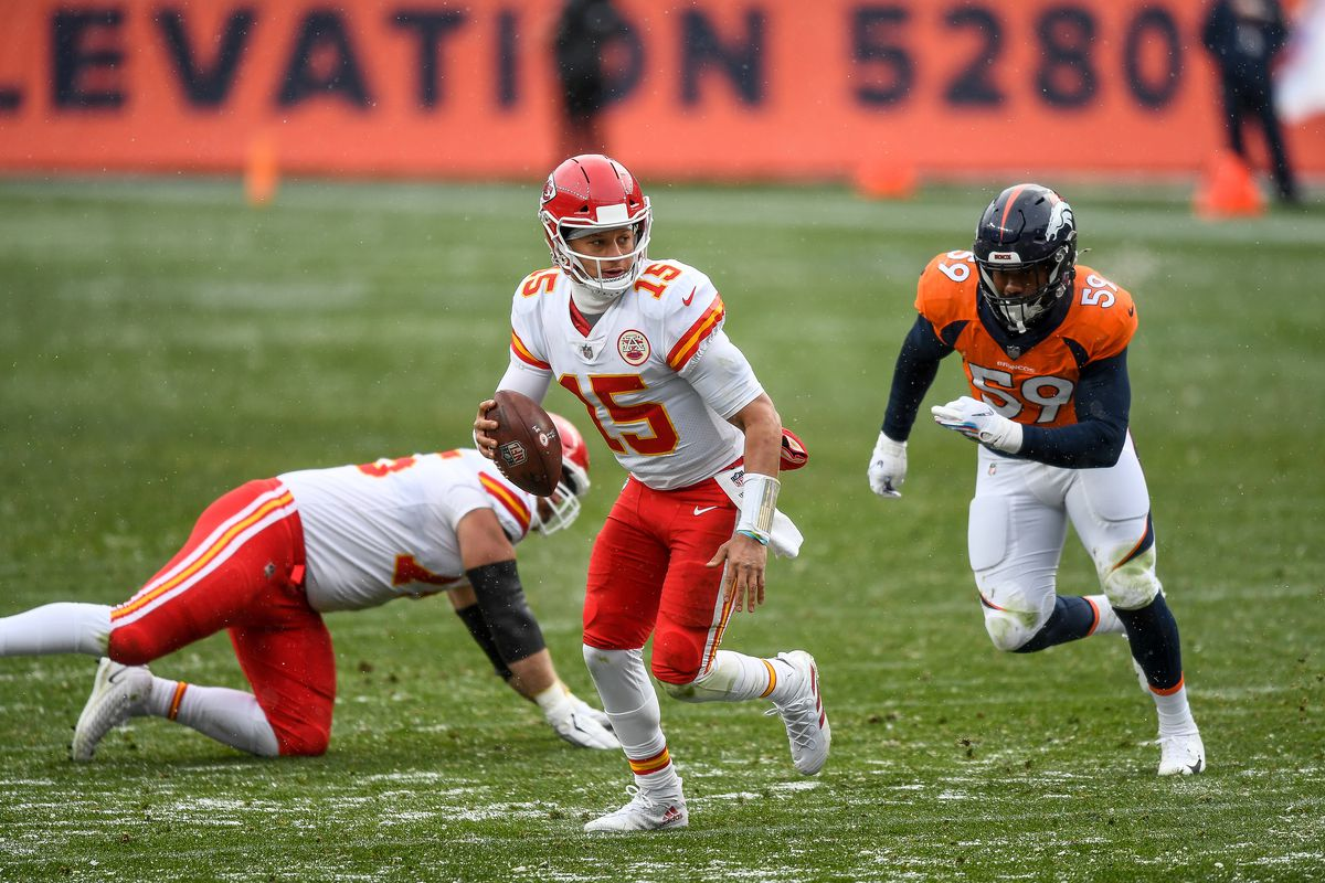Patrick Mahomes #15 of the Kansas City Chiefs scrambles out of the pocket in the third quarter of a game against the Denver Broncos at Empower Field at Mile High on October 25, 2020 in Denver, Colorado.