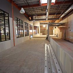 A view from the back bar towards Broadway.  A two-lane bowling alley is under construction towards the right.