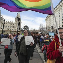 LGBT supporters march near The Church of Jesus Christ of Latter-day Saints' Salt Lake Temple in Salt Lake City on Friday, March 6, 2020, during a protest of the honor code at the faith's universities.