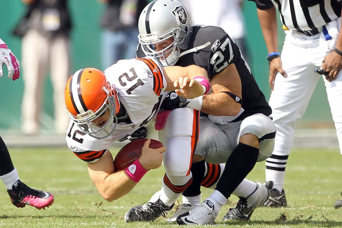 OAKLAND, CA - OCTOBER 16:  Colt McCoy #12 of the Cleveland Browns is sacked by Matt Giordano #27 of the Oakland Raiders at O.co Coliseum on October 16, 2011 in Oakland, California.  (Photo by Ezra Shaw/Getty Images)