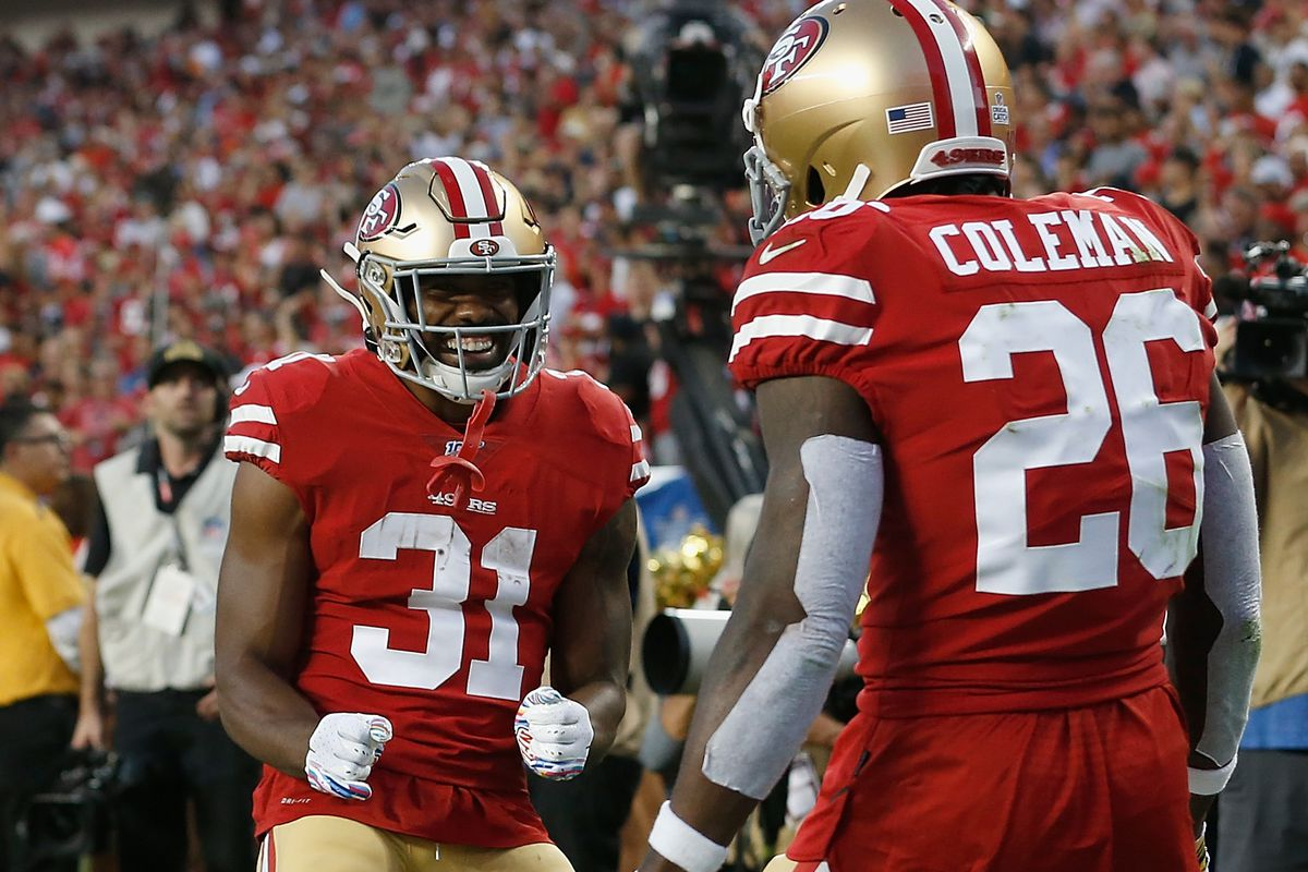 Tevin Coleman of the San Francisco 49ers celebrates with Raheem Mostert after scoring a touchdown in the second quarter against the Cleveland Browns at Levi's Stadium on October 07, 2019 in Santa Clara, California.