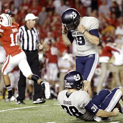 Wisconsin's Devin Smith (10) reacts after Utah State kicker Josh Thompson (19) misses a field goal attempt in the final seconds on Saturday.