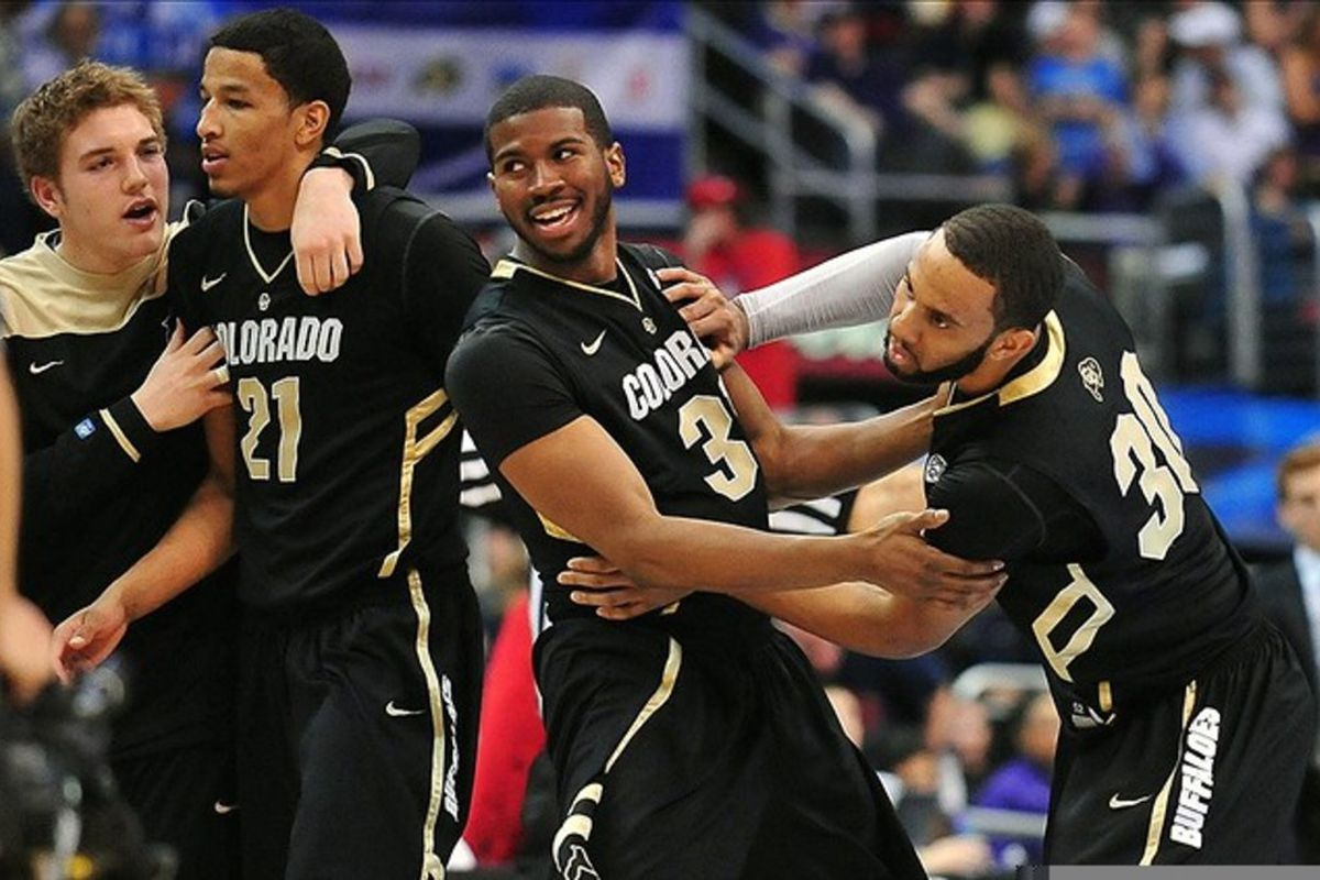 March 10, 2012; Los Angeles, CA, USA; Colorado Buffaloes celebrate the 53-51 victory against the Arizona Wildcats during the championship game of the 2012 Pac 12 Tournament at Staples Center. Mandatory Credit: Gary A. Vasquez-US PRESSWIRE