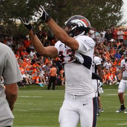 WR Eric Decker reaches for a pass in the corner of the endzone during drills