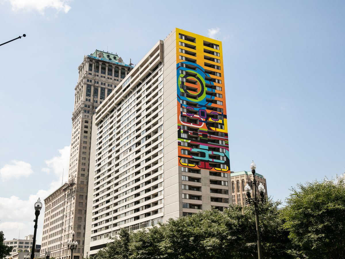 A large white building with a mural on the side of it.