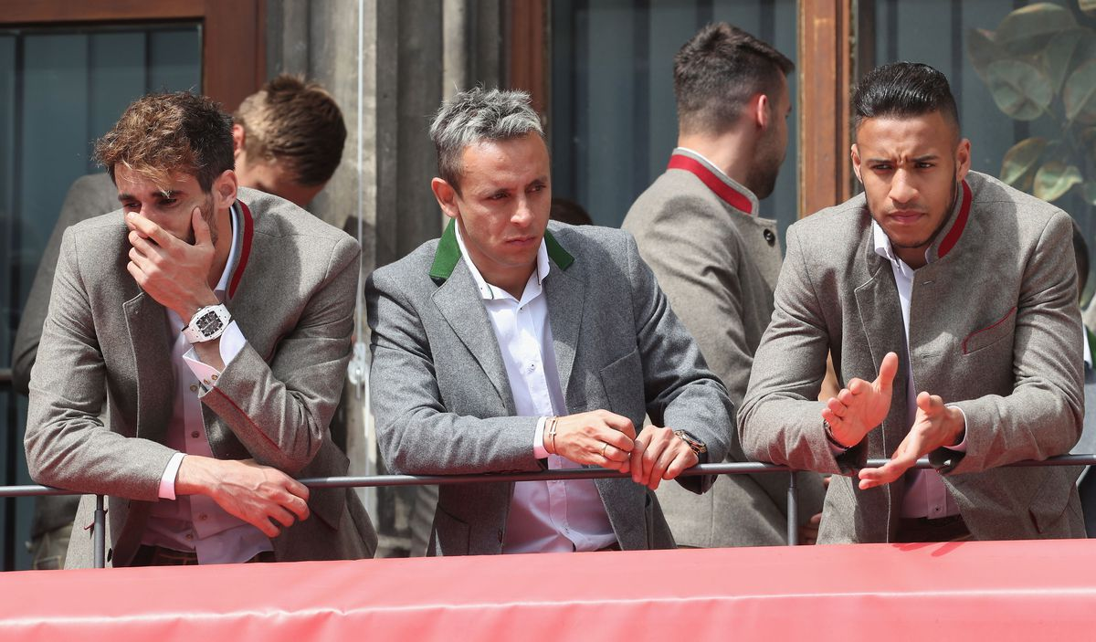 MUNICH, GERMANY - MAY 20: Javi Martinez, Rafinha and Corentin Tolisso (L-R) of FC Bayern Muenchen are pictured during the ceremony celebrating the team's German Championship title for the season 2017/18 on the balcony of the town hall on May 20, 2018 in Munich, Germany.