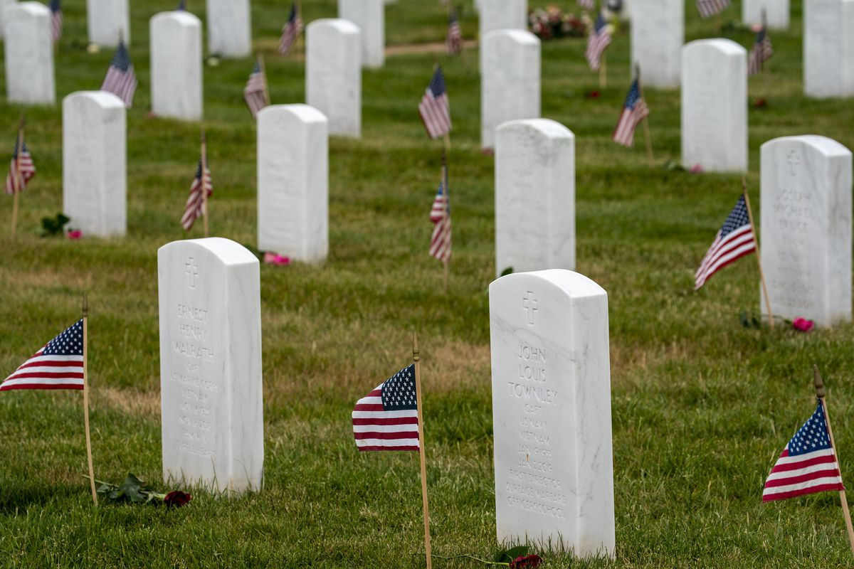 50,000 Flowers Placed At Arlington National Cemetery For Memorial Day