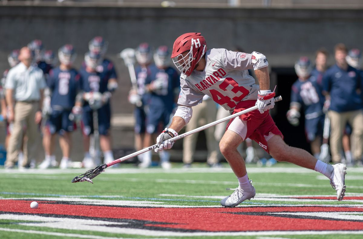 Noah Knopf in action for Harvard lacrosse.