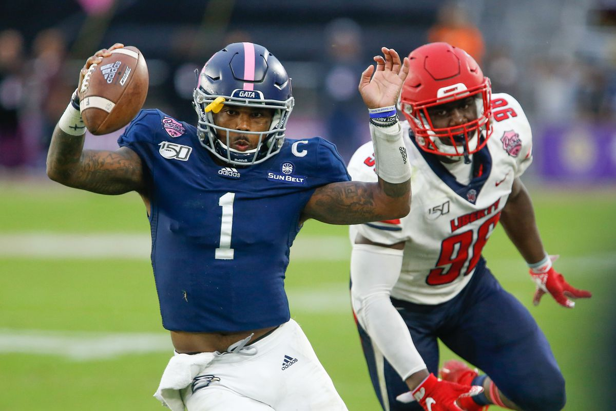 Liberty Flames defensive lineman Tre'Shaun Clark (96) chases Georgia Southern Eagles quarterback Shai Werts (1) during the second half of the Cure Bowl at Exploria Stadium. Mandatory Credit: Reinhold Matay