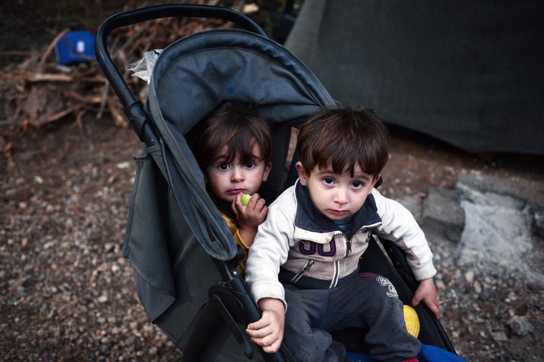 Two refugee children in a stroller
