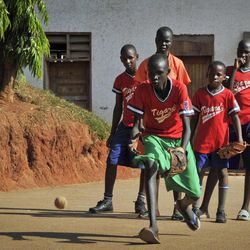 In this photo taken Wednesday, March 28, 2012, pupils of the Rev. John Foundation school take part in baseball training at the school in Kampala, Uganda. Unlike in most of Africa, soccer is not the top sport at the school in Uganda's capital - instead the fairly foreign American game of baseball is No. 1 and catching on quickly.