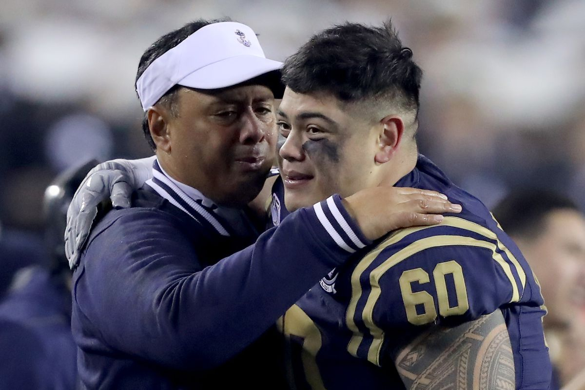 Head coach Ken Niumatalolo of the Navy Midshipmen celebrates with TJ Salu #60 late in the fourth quarter at Lincoln Financial Field on December 14, 2019 in Philadelphia, Pennsylvania.The Navy Midshipmen defeated the Army Black Knights 31-7.