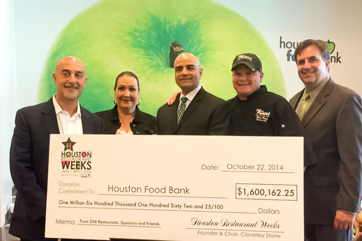 Cleverley Stone (center) presenting HRW check to Houston Food Bank