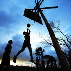 Men play basketball near the airport in Tacloban, Thursday, Nov. 21, 2013.