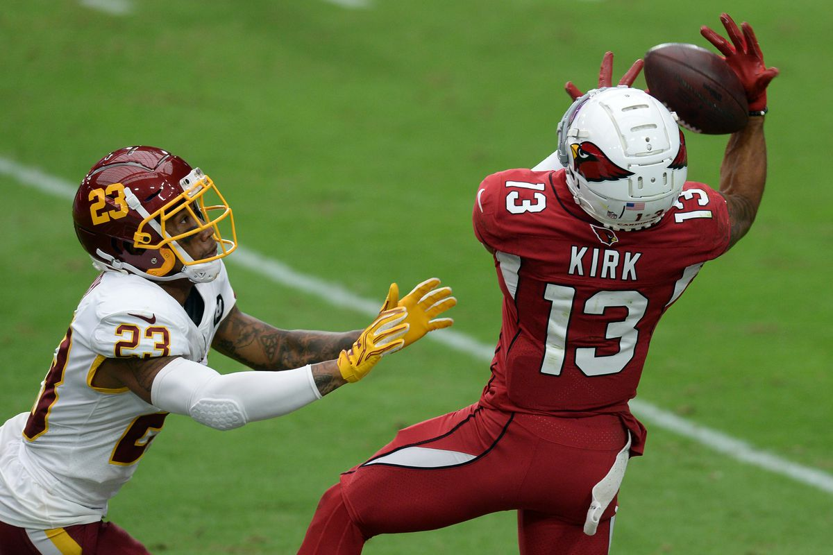Arizona Cardinals wide receiver Christian Kirk (13) makes a catch against Washington Football Team cornerback Ronald Darby (23) during the first half at State Farm Stadium.