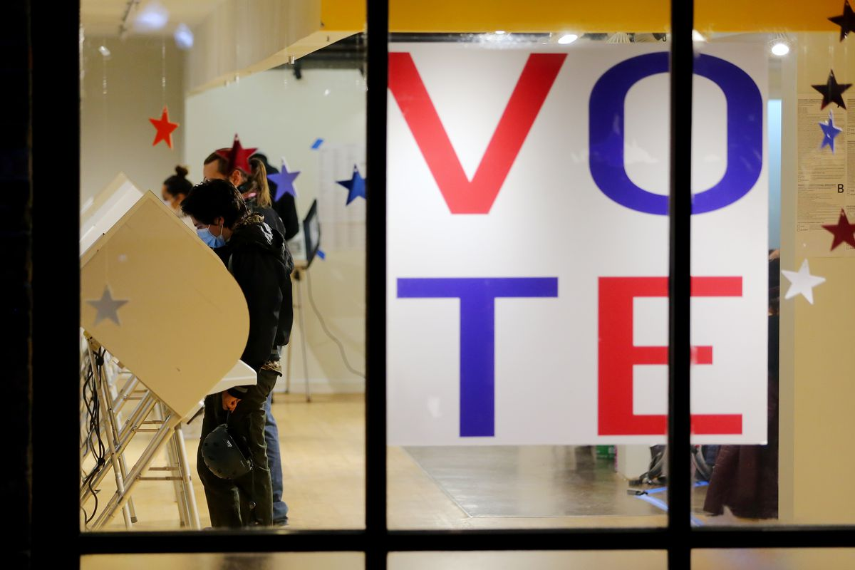 Voters cast their ballots at Trolley Square in Salt Lake City on Tuesday, Nov. 3, 2020.